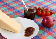 Grana cheese with onion jam Stock Images