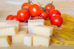 Grana padano with pasta and tomatoes Stock Photo