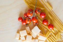 Grana padano with pasta and tomatoes Stock Photos