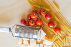 Grana padano with pasta and tomatoes Royalty Free Stock Photography
