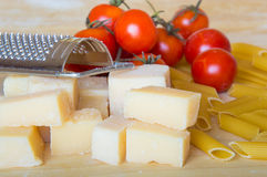 Grana padano with pasta and tomatoes Royalty Free Stock Images