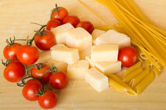 Grana padano with pasta and tomatoes Royalty Free Stock Photo