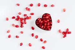 Granaatappelzaden in de hart-vormige vorm Royalty-vrije Stock Foto