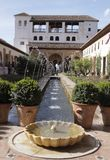 Granada - Alhambra. Patio de la Acequia with its water features and its rich colony of plants as the part of palace complex Alhambra, Granada royalty free stock photo