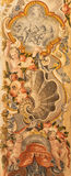 Granada - baroque decoration fresco with the angels and flowers in Basilica San Juan de Dios. GRANADA, SPAIN - MAY 29, 2015: The symbolic baroque decoration Stock Images
