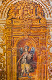 Granada - The baroque fresco of angel with the staff and shield in nave of church Monasterio de San Jeronimo Stock Photo