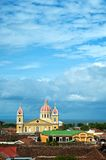 Granada Cathedral. As seen over the red tile roofs of the historic city of Granada, Nicaragua Stock Photos
