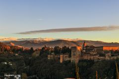 Granada city, Andalucia, Spain. Close up image of Alhambra palace and fortress with Sierra Nevada at the background in the sunset royalty free stock image