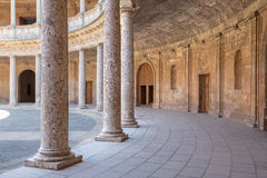 Granada - The columns and atrium of Alhambra palace of Charles V. Stock Photos