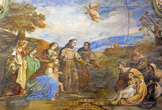 Granada - das Fresko der Szene als St Anthony von Padua befestigt den Fuß des jungen Mannes in der Kirche Monasterio de San Jeron lizenzfreie stockbilder