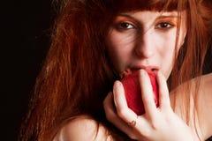 Granada de la cara y del rojo de la muchacha Imagen de archivo
