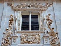 Granada - detalle del portal renacimiento-barroco de Colegio de Ninas Nobles de Juan de Marquina (16 centavo ) Foto de archivo libre de regalías