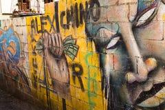 Granada, Espa?a - 27 de mayo de 2019: Pintada colorida de un artista desconocido en la pared foto de archivo libre de regalías