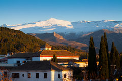 Granada in evening with Sierra Nevada in  background Stock Photography