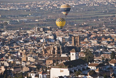 Granada flying balloons. Two hot air balloons flying over the cathedral of Granada Royalty Free Stock Photos