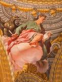 Granada - freskomålningen av St John evangelisten i den barocka fristaden (helgedomar Sanctorum) i kyrkliga Monasterio de la Cart Royaltyfria Bilder