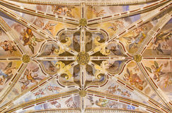 Granada - The gothic ceiling with the frescoes of back part of nave in the church Monasterio de San Jeronimo. Stock Photos