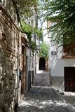 Granada great historic city of Spain-Andalusia, Old Town. Charming narrow footpath and trees Royalty Free Stock Photos