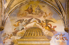 Granada - The Holy Trinity among the angels fresco in the church Monasterio de San Jeronimo Royalty Free Stock Images