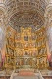 Granada - huvudsakligt altare för presbyterium och för mannerist av kyrkliga Monasterio de San Jeronimo av Pablo de Rojas från 16 Arkivbilder