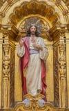 Granada - il cuore della statua di Gesù sull'altare laterale barrocco nella chiesa di Iglesia de san Anton da 17 centesimo Fotografie Stock
