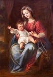 Granada - Madonna die (Virgin van de Rozentuin) in kerk Monasterio DE La Cartuja schilderen royalty-vrije stock afbeelding