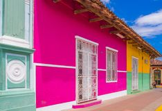 Free GRANADA, NICARAGUA, MAY, 14, 2018: Outdoor View Of Facade Buildings With Pink Wall, Wooden Door And Roof In A Gorgeous Stock Image - 117965321