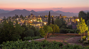 Granada - The outlook over the the town from Generalife gardens of Alhambra Stock Photos