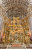 Granada - presbytery and  mannerist main altar of church Monasterio de San Jeronimo by Pablo de Rojas from 16. cent. Granada - The presbytery and  mannerist Stock Images