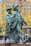 Statue of romantic travelers. GRANADA, SPAIN - DECEMBER 31, 2017: Statue of romantic travelers spanish: ESTATUA DE LOS VIAJEROS ROMANTICOS - located on the Paseo Royalty Free Stock Images