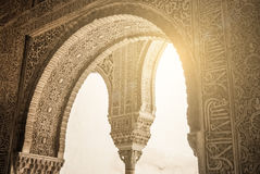 GRANADA, SPAIN - FEBRUARY 10, 2015: A close-up view to calligraphy decorated details of an archway at palace of Alhambra, Granada Stock Image
