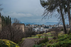 GRANADA, SPAIN - FEBRUARY 10, 2015: A view to Granada city and towers of a castle of Granada on winter rainy cloudy day. Andalusia, Granada, Spain Stock Photography