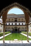 Courtyard of the Myrtles in day time at Alhambra. GRANADA, SPAIN - JULY 16, 2011: Courtyard of the Myrtles in day time at Alhambra royalty free stock photos