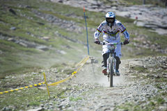 GRANADA, SPAIN - JUNE 30: Unknown racer on the competition of the mountain downhill bike Bull bikes Cup DH 2013, Sierra Nevada Royalty Free Stock Images