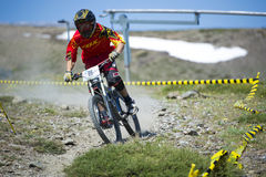 GRANADA, SPAIN - JUNE 30: Unknown racer on the competition of the mountain downhill bike Bull bikes Cup DH 2013, Sierra Nevada Stock Photos