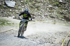 GRANADA, SPAIN - JUNE 30: Unknown racer on the competition of the mountain downhill bike Bull bikes Cup DH 2013, Sierra Nevada. Competition mountain downhill royalty free stock photos