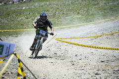 GRANADA, SPAIN - JUNE 30: Unknown racer on the competition of the mountain downhill bike Bull bikes Cup DH 2013, Sierra Nevada. Competition mountain downhill royalty free stock images