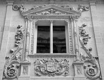 GRANADA, SPAIN - MAY 29, 2015: Detail from renaissance-baroque portal of Colegio de Ninas Nobles by Juan de Marquina Stock Image