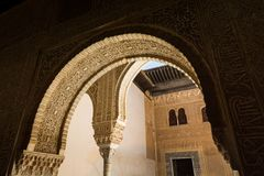 GRANADA, SPAIN - MAY 2017: Inside Alhambra Nasrid Palaces, plaster inscriptions stock image