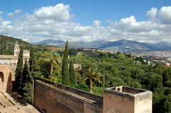 Granada, Spain: View from Alhambra. View from the battlements of the historic Alhambra complex over the verdant, forested hills and distant Sierra Nevada Stock Photo