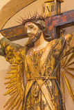 Granada - The stylized Jesus Christ on the cross as the priest in Iglesia de san Anton. Royalty Free Stock Photography