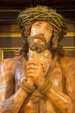 Granada - tortured Jeus Christ in Bond statue in church Iglesia de los santos Justo y Pastor. Royalty Free Stock Photo
