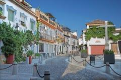 Granada - Uliczny Calle dyrektor De San Bartolome w Albazyin okręgu Obraz Stock