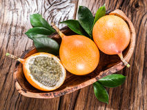Granadilla fruits on the wood. Granadilla fruits on the wooden table Royalty Free Stock Photos
