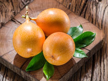 Granadilla fruits on a wooden table. Stock Images