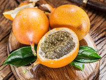 Granadilla fruits on a wooden table. Stock Photos