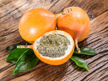 Granadilla fruits on a wooden table. Granadilla fruits on the wooden table Royalty Free Stock Images