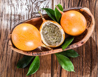 Granadilla fruits on a wooden table. Granadilla fruits on the wooden table Stock Image