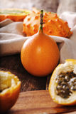 Granadilla and kiwano. Sweet granadilla fruit on the table Royalty Free Stock Photo