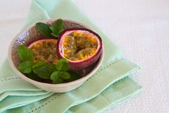 Granadilla with mint Stock Images